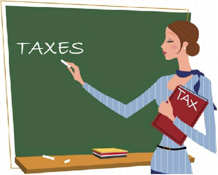Image of lady teacher in front of a green school board writing the word Taxes across